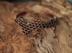 Its not just a piece of metal cast in hexagon form. Its real and natural honeycomb piece, covered with copper (electroformed, or electroplated with copper), to create this unique bracelet for a bee lovers. Heres your chance to wear real honey combs, that will stay with you as long, as you