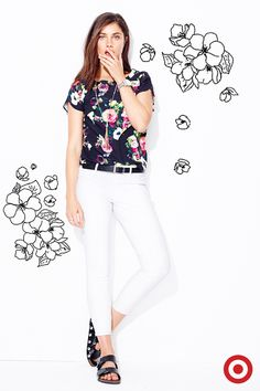 Elevate your spring wardrobe with a floral top that pairs perfectly with white skinny jeans and sandals.