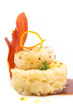 Orange infused risotto, sous vide cooked scallops, orange and port reduction, watercress in olive oil, saffron butter, prosciutto chip, candied orange zest.