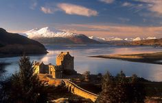 """Eilean Donan Castle and the Isle of Skye, Winter. Highland Scotland."" by photosecosse /barbara jones"