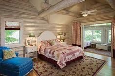 The Brookses showcase their patriotism in the two upper-level whitewashed guest bedrooms by implementing blue-and-white and red-and-white color schemes, respectively. Each room also features a glass-enclosed three-season porch with twin beds.