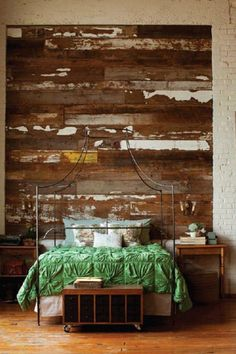 Amazing reclaimed wood wall & I'm loving almost everything else-- but not the green bedspread...