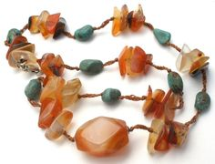 """Brown and Blue Handmade Jewellery - This is a hand knotted necklace of carnelian, agates and turquoise nugget gemstones with a sterling silver clasp. It is 17"""" long, hallmarked 925 on clasp, weighs 25"""