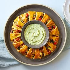 The avocado dip is the perfect condiment for this chicken, bacon, and kale ring that presents beautifully, but is a breeze to make. Crescent Dough, Crescent Rolls, Crescent City, Chicken Club, Chicken Bacon, California Chicken, Pampered Chef Recipes, Pampered Chef Ring Recipe, Avocado Dip