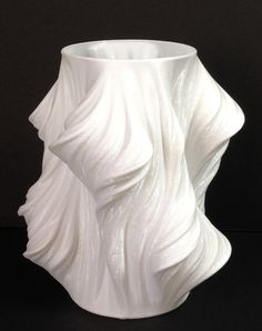 Tantalize your friends and family with this mathematical curiosity.  Designed by Virtox in the Netherlands, this vase is generated from elements  of the Julia Set, an iterative mathematical concept known as a Fractal. The  flowing self-similar patterns catch the eye and provoke the emotions. The