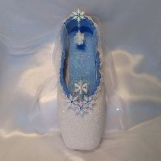 """Snow Queen. Frozen """"ice"""" crystals, snowflakes with blue Swarovski accents."""