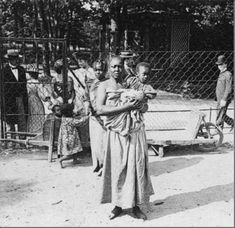 """Woman and child on exhibit at a """"human zoo"""". I didn't want to believe that they actually existed either. But look it up--it's a disgustingly true piece of American and European history"""