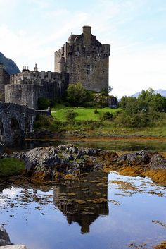 Reflecting on Eilean Donan...    Eilean Donan Castle in Scotland! It's easy to see why its the most photographed castle in Scotland - it's absolutely stunning and the location is perfect.