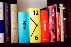 Give your book collection a unique touch with this book clock. Designed to look like three colorful books standing next to each other, this clever clock will inconspicuously fit right in on your book shelf, and makes a great house warming gift idea. Book Clock, Book Art, Diy Clock, Clock Ideas, Clock Decor, Diy Recycling, Take My Money, Vintage Design, Vintage Style