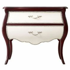 "Pairing bold style with classic appeal, this 2-drawer chest features chic nailhead details and a curvaceous bombe silhouette.  Product: ChestConstruction Material: Hardwood solids, resin, leather and MDFColor: Cherry and whiteFeatures:  Two drawersNailhead trimDimensions: 30.25"" H x 34.75"" W x 16"" D"