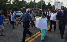 Tensions Ease in Ferguson as Missouri Highway Patrol Captain Marches With Protesters