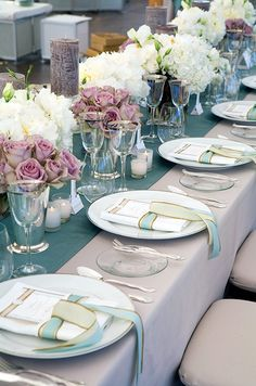 These dark purple candles against the soft pink and white florals is so sublte but totally completes the look.