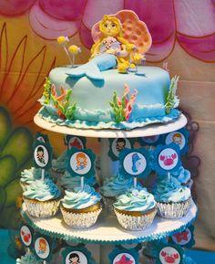 Image from http://cdn1-blog.hwtm.com/wp-content/uploads/2012/05/under-the-sea-mermaid-fondant-cake-topper.jpg.