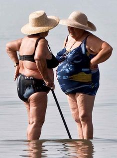 Two old women chatting in the sea.