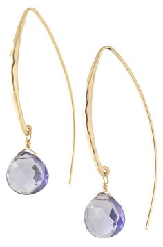 """ARC DROP EARRINGS $39 Delicate, elegant amethyst glass stones add a subtle glow to tips of graceful arches of gold tone brass earwire in face-flattering length. 2"""" drop in length. Lead & nickel safe. Selecting the initials of her beloved grandmother, Carla Greengrass christened her piece the ARC Drop Earrings. Carla adored her grandmother with all of her heart and boasts that she was strong and elegant, much like the ARC Drop earrings."""