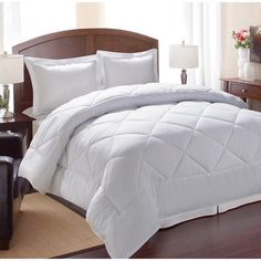 This reversible down alternative comforter will allow you to enjoy year-round comfort. The 100-percent polyester diamond-sewn stitch comforter is filled with polyester cluster fibers that mimic the feel of down.