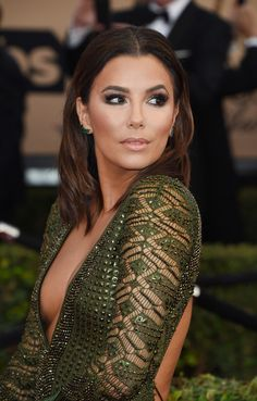 Eva Longoria Photos - Actress Eva Longoria attends the 22nd Annual Screen Actors Guild Awards at The Shrine Auditorium on January 30, 2016 in Los Angeles, California. AFP PHOTO / MARK RALSTON / AFP / MARK RALSTON - 22nd Annual Screen Actors Guild Awards - Arrivals
