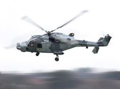 The first Royal Navy Wildcat Attack Helicopter undertakes its maiden flight at AgustaWestland in Yeovil, Somerset. The Wildcat has a more powerful engine allowing it to be flown in extreme conditions all year round. It is also equipped with a more robust fuselage, a high tech interactive display and a new radar system that provides 360 degree surveillance.