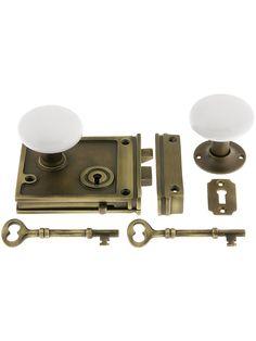 Flush Mount Door Locks. Antique Brass Horizontal Rim Lock Set With White Porcelain Door Knobs
