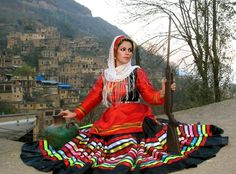 Gilaki Girl in traditional Dress holding a rifle, Gilan Province, Iran.