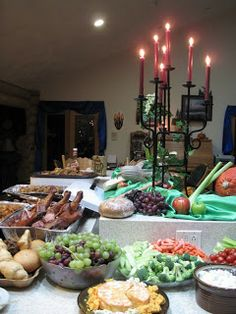 Medieval Party Food - cheese, heavy breads an meats.No utensils!                                                                                                                                                     More