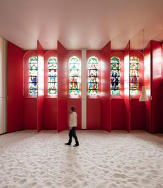 """Historic chapel remodel by tccp. Photo: Luc Roymans  """"The architectural structure and integrity of the original chapel in Grand-Bigard, Belgium was kept unchanged—all of the redesign's attention went to the refurbishment of the interior. The traditional features of the old chapel, like its apse and stained glass windows, were 'hatched in.' This creates a totally new and unexpected environment."""""""