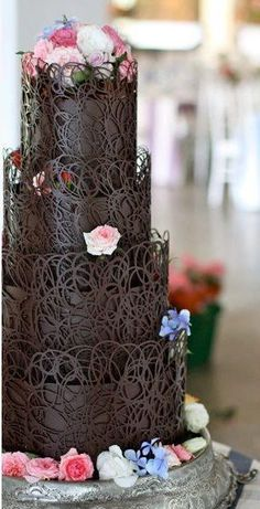 Absolutely wonderful chocolate covered cake. Beautiful wedding cake.