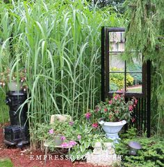 These garden mirror ideas show ways to display mirrors outdoors in home gardens. Also includes safety tips, ways to weather proof mirrors, and answers to frequently asked questions. Outdoor Mirrors Garden, Garden Mirrors, Mirrors In Gardens, Old Door Projects, Diy Garden Projects, Patio Fence, Backyard Fences, Contemporary Garden Design, Fence Art