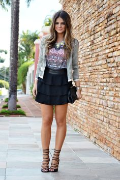 tribal T-shirt, wrap sandals, and neon necklace