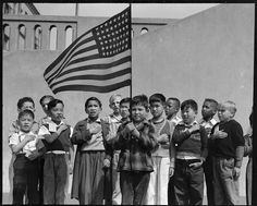 Children pledging allegiance to the American flag at San Francisco's Raphael Weill Elementary School in 1942. Those whose families were of Japanese ancestry were sent to internment camps.  (US National Archives: Dorothea Lange)