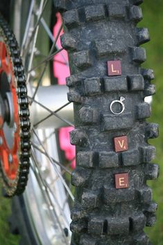 Dirt bike - engagement.<3 How original! Really adorable idea for a dirt biker and his lady. (;: