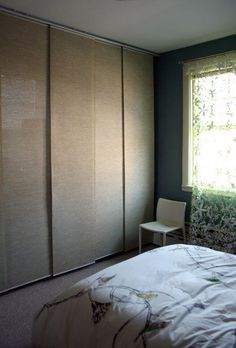 Before & After: Hiding the Great Wall of Clothes using IKEA Kvartal system s/ Anno Sanel beige flat panel Curtains. Would be $270 for system & panels for both closets :/: