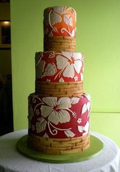 Another great design from Rick And Sasha of Cake Lava:  Love the hibiscus pattern! (Someday I want to try a custom stencil pattern; it's hard to believe anyone can get edges that crisp!) Also, how perfect is that fade from red to orange?
