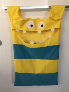 "Inspiration came from the link I have tagged. Going on the colour theme I used, you could even make a ""hungry Minion"" laundry bag! I also left a slit in the top of his head to accommodate a coat hanger so it can be hung on a door handle rather than a towel rail."