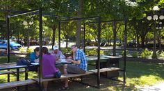 Seating in parks can incorporate art. It can also provide a place for people to have an outdoor meeting.