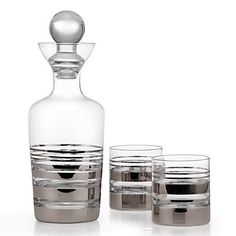 For just the two of you, make a toast in high style with our chic Salud decanter set, accented with brilliant Silver metallic stripes.