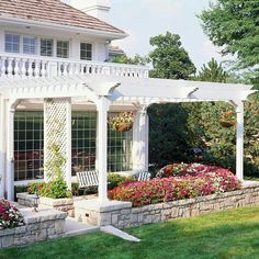 Replace the patio with a deck, and this is the feel of our rear deck (and maybe the trellis over the pool house).  Except we may stain not paint the upper structures.