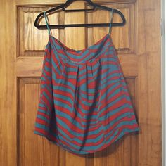 Red/Blue-Turquoiseish Skirt w/ pockets Very comfortable. Has plenty of give for a medium with a elastic waistband in the back. Good condition. Pockets are a cute added detail! Skirts Midi