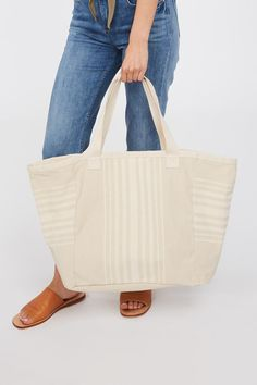 The Kiera Canvas Tote Bag is perfect for summer trips to the beach. Its simple and roomy design will last seasons. Introducing Elementary - relaxed, timeless silhouettes in natural fabrics, think Summer Travel, Simple Living, Canvas Tote Bags, Cotton Canvas, Silhouettes, Organic Cotton, Trips, Fabrics, Seasons