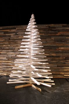 With pallet wall back drop, the Christmas tree is made of sticks of wood