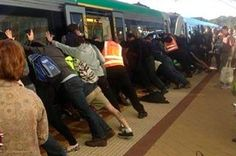 Commuters Push Train Off Trapped Man