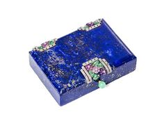A French Lapis, Jade, Amethyst and Diamond Compact, Van Cleef & Arpels, Paris. Of rectangular form having floral decoration, the interior having a fitted compartment.
