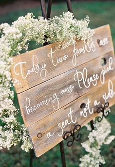 Rustic wood with white lettering, framed by baby's breath.great wedding sign, this is exactly how I want it to look. Baby's breath and everything Wedding Ceremony Seating, Ceremony Signs, Wedding Signage, Wedding Reception, Reception Backdrop, Wedding Church, Church Ceremony, Chalkboard Wedding, Reception Ideas