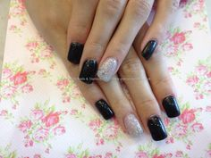 Acrylic nails with black and silver gel polish