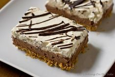 Chocolate-Layered No-Bake Cheesecake Bars  Crust  1 1/2 cups graham cracker crumbs  1/4 cup (1/2 stick) butter, melted  2 tablespoons sugar    Filling  8 ounces semi-sweet chocolate, divided  4 packages (8 oz. each) cream cheese, softened  1/2 cup sugar  1 teaspoon vanilla  1 tub (8 oz.) whipped topping (aka, Cool Whip – no one's judging), thawed