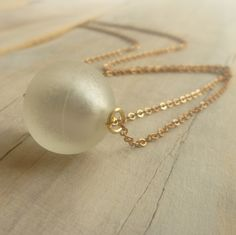 White Ghost Vintage Necklace ... Silvery White Vintage Glass Mottled and Tarnished Sphere. £9.00, via Etsy.