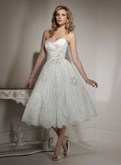 """""""Isadora Ann - by Maggie Sottero"""" I don't care for tea-length, personally, but this is the first short gown I've seen that really screams """"wedding."""" Lovely!"""