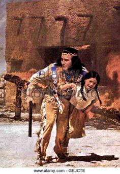 Pierre Brice In letzter Sekunde rettet Winnetou (Pierre Brice) ein kleines Maedchen aus den Flammen.       *** Local - Stock Image