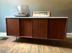 A personal favorite from my Etsy shop https://www.etsy.com/listing/253054200/mid-century-modern-sliding-door-credenza