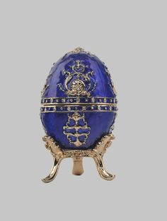 A spectacular handmade Music Playing blue Faberge egg.  This piece is a unique one of a kind piece made for art lovers who get inspired by beautiful